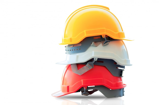 Safety helmet stacked on isolated. Premium Photo