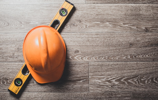 Safety helmet and tools to architect on wooden Premium Photo
