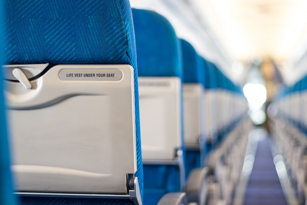 Safety message on passenger seats of the airplane Premium Photo
