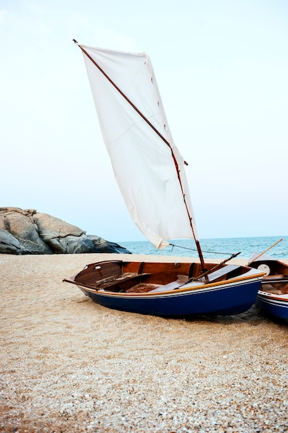 Sail boats sea shore lifesaver flotation life buoy rock formation concept Free Photo