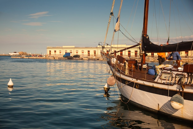 Sailboat parked in the trieste pier Premium Photo