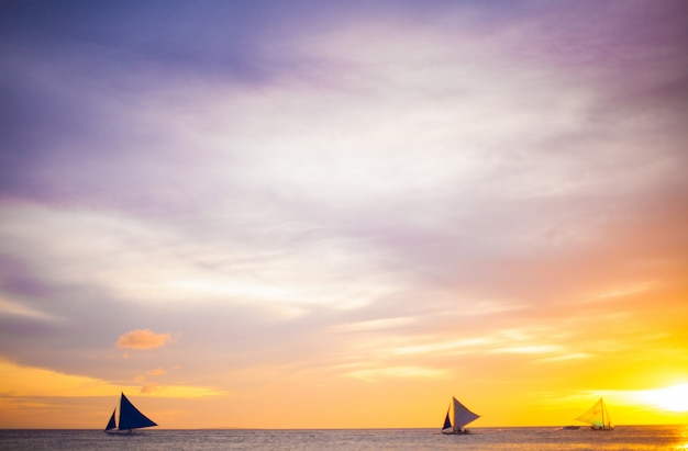 Sailing boat to the sunset in boracay island on philippines Premium Photo