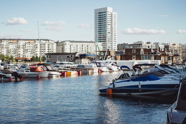 Sailing boats and yachts on the pier in stockholm front of the city center Free Photo