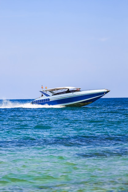 Sailing ship, speed boat, yacht on the sea Premium Photo