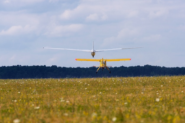 Sailplane and a towing aircraft starting on an airfield Premium Photo