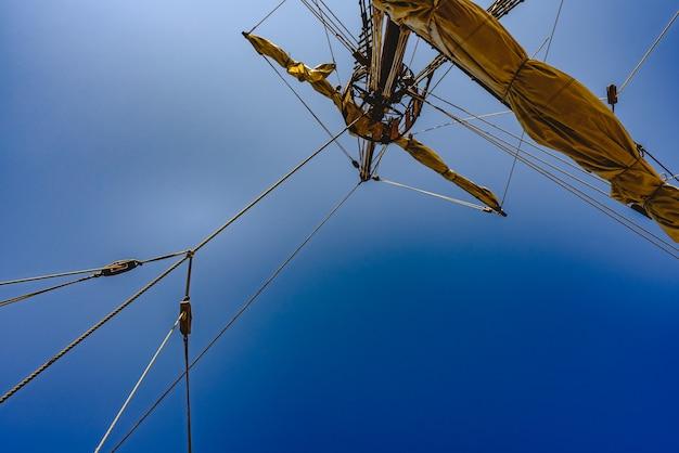 Sails and ropes of the main mast of a caravel ship, santa marãa columbus ships Premium Photo