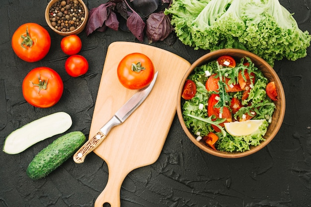 Salad and cutting board Free Photo