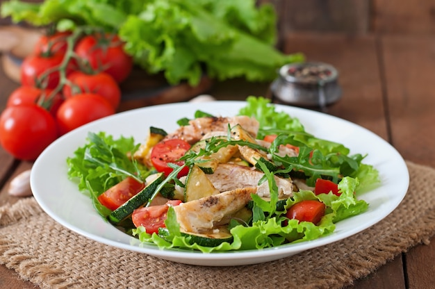Salad of chicken breast with zucchini and cherry tomatoes Free Photo
