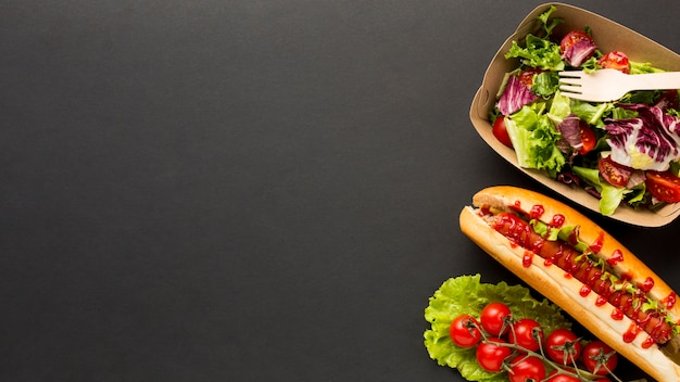 Salad and fast food with copy space Free Photo