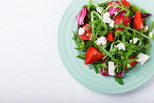 Salad of fresh strawberries. snack on summer parties. Premium Photo