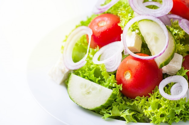 Salad on a white plate Free Photo