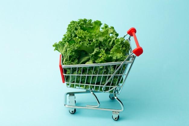Salad in a supermarket cart. Premium Photo