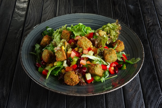 Salad with beans, falafel and vegetables Premium Photo