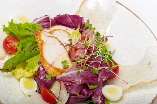 Salad with chicken on a white plate Premium Photo