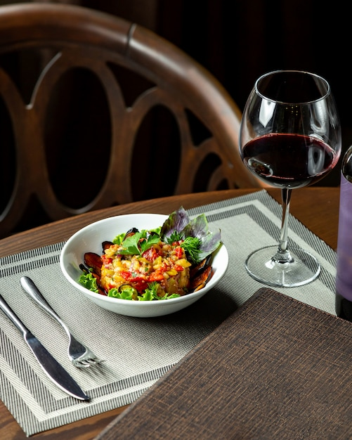 Salad with eggplant and glass of red wine Free Photo