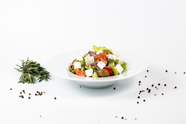 Salad with feta cheese olives and fresh vegetables Free Photo