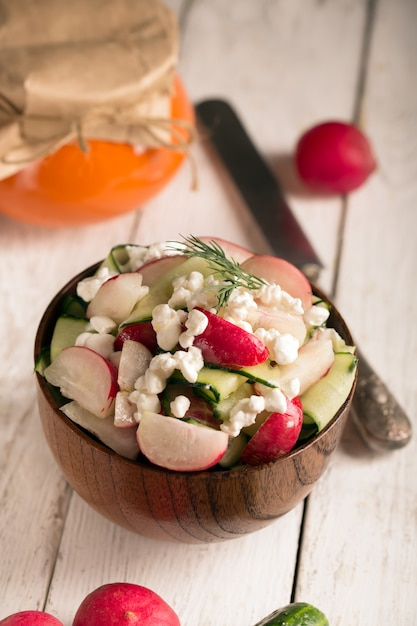 Salad with fresh vegetables and cottage cheese. white background Premium Photo