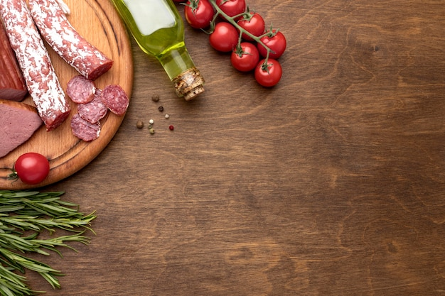 Salami and fillet meat on wooden board with copy-space Free Photo