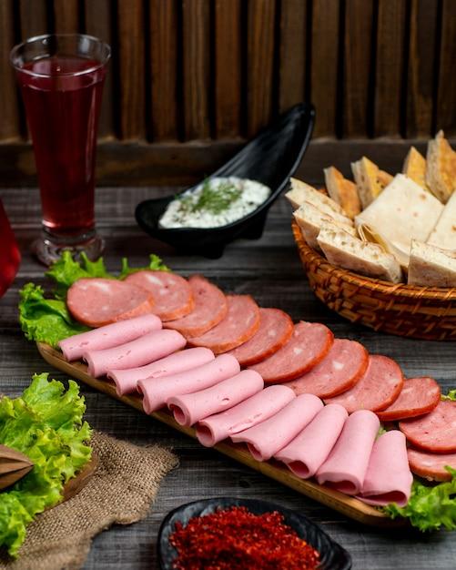 Salami platter with pepperoni and salami Free Photo