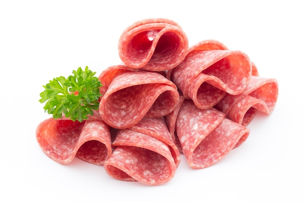 Salami sausage slices isolated on white. Premium Photo