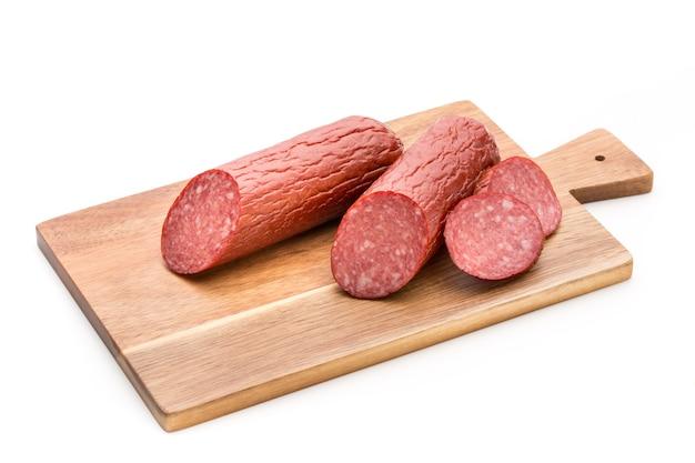 Salami smoked sausage, basil leaves isolated Premium Photo