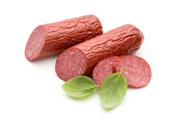 Salami smoked sausage, basil leaves isolated Premium Photo