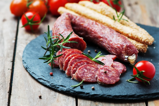 Salami on the wooden table Premium Photo