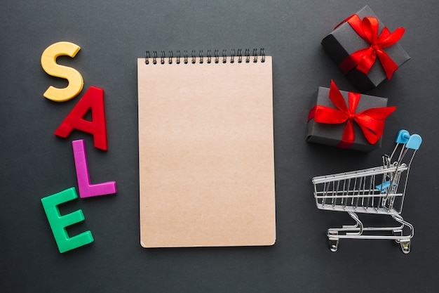 Sale concept with mock-up notebook Free Photo