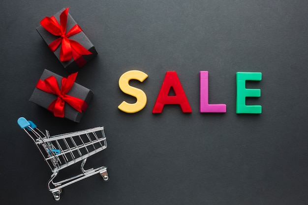 Sale concept with shopping cart Free Photo