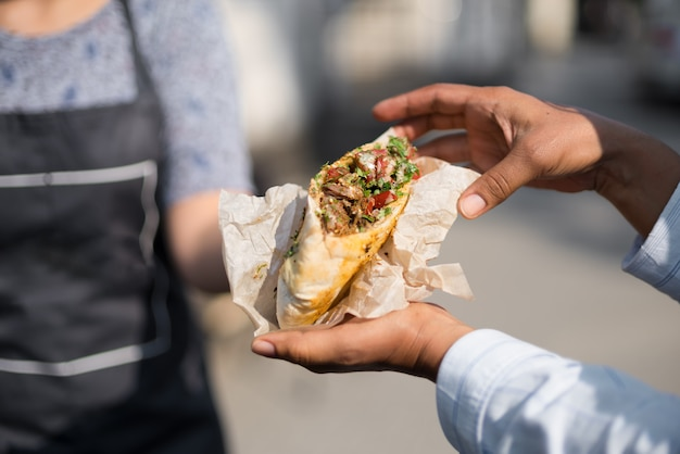 Sale falafel and fresh vegetables in pita bread. Premium Photo