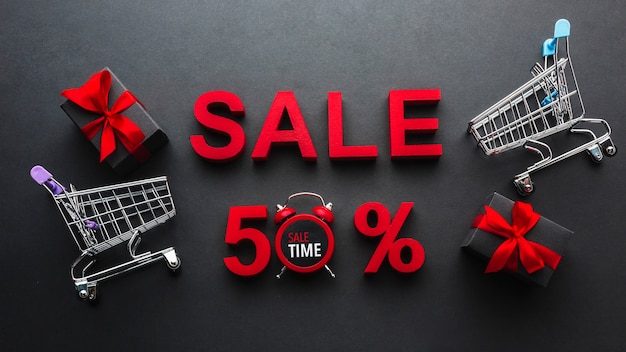 Sale fifty percent discount with shopping carts Free Photo