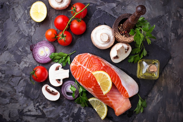Salmon, mushrooms, tomatoes and parsley. balanced diet, healthy food. selective focus Premium Photo
