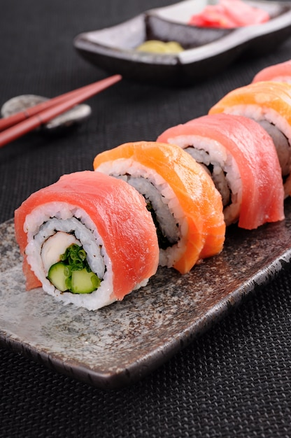 Salmon sushi roll on a plate Free Photo