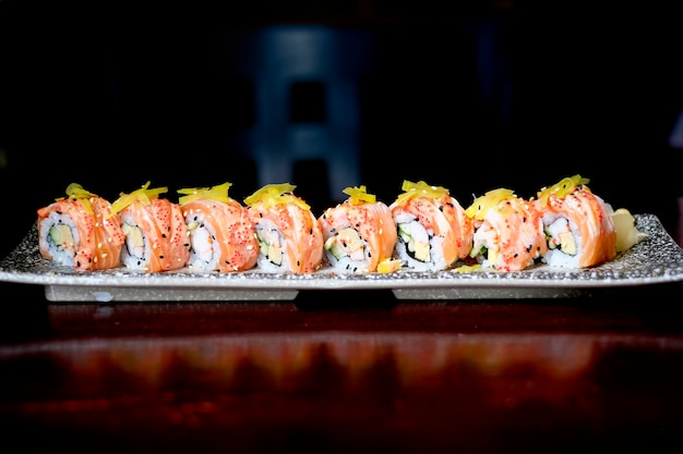 Salmon sushi roll with spicy sauce, japanese food style Premium Photo