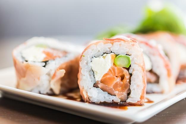 Salmon sushi roll Free Photo