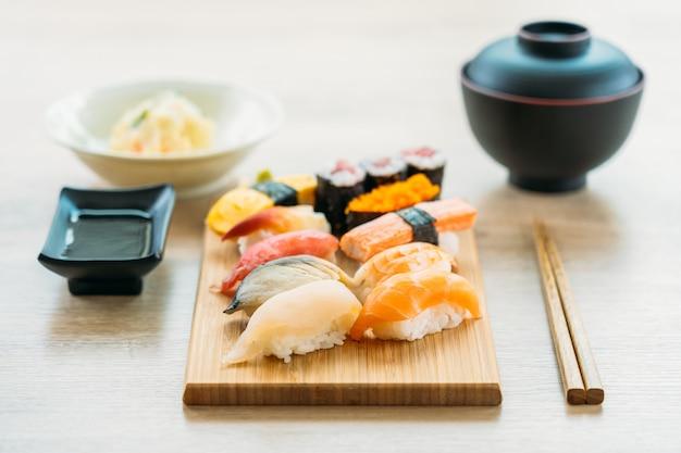 Salmon tuna shell shrimp and other meat sushi maki Free Photo