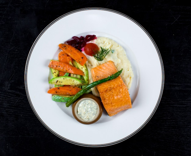 Salmon with fried vegetables and mashed potatoes Free Photo
