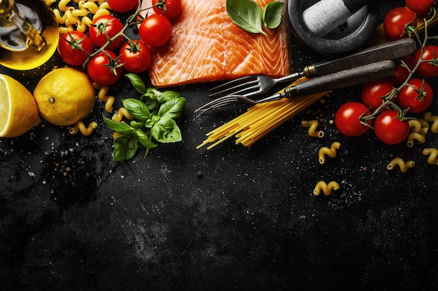 Salmon with ingredients on table Free Photo