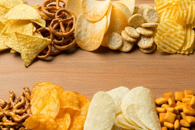 Salty snacks. pretzels, chips, crackers Premium Photo