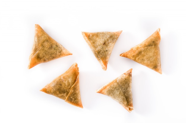 Samsa or samosas with meat and vegetables isolated on white. Premium Photo