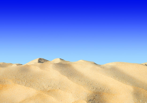 635f38fbbf Sand on the beach on the blue sky background. Photo | Premium Download