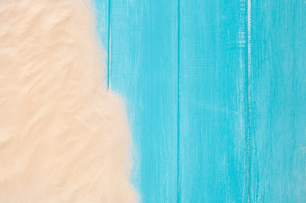Sand border on blue wooden background with copy space Free Photo