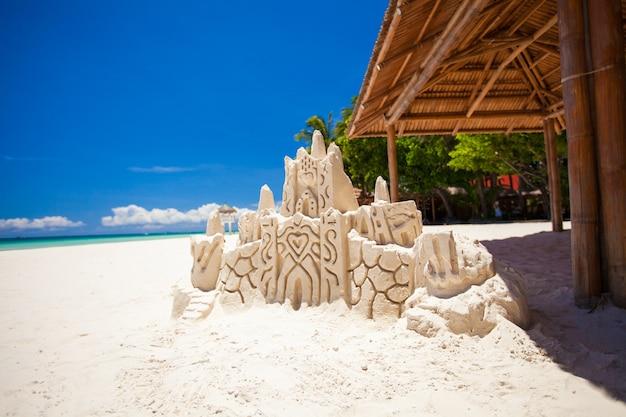 Sand castle on a white tropical sandy beach in boracay,philippines Premium Photo