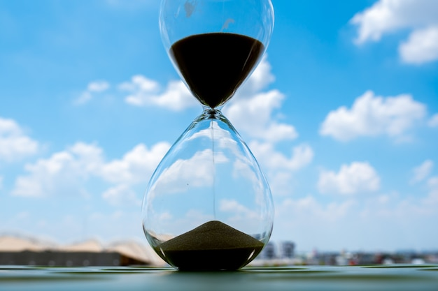 Sand clock with sky and cloud business concept Premium Photo