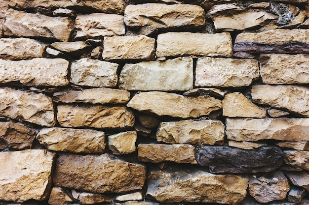 Sandstone wall textured background Free Photo
