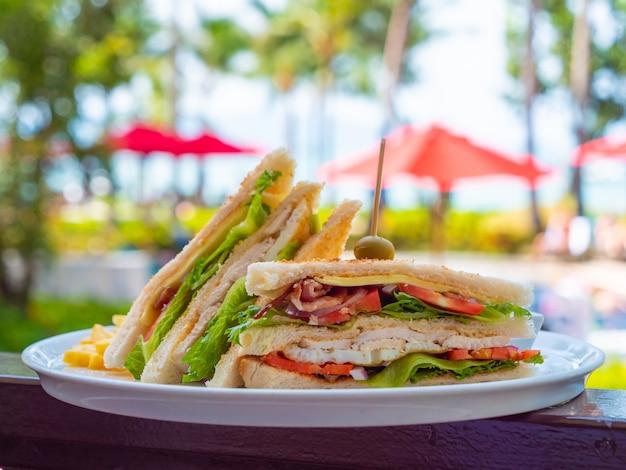 Sandwich for breakfast in white plate Free Photo