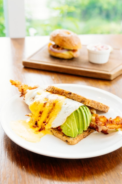 Sandwich with avocado bacon and asparagus Free Photo