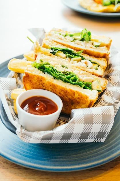 Sandwich with avocado and chicken meat with french fries Free Photo