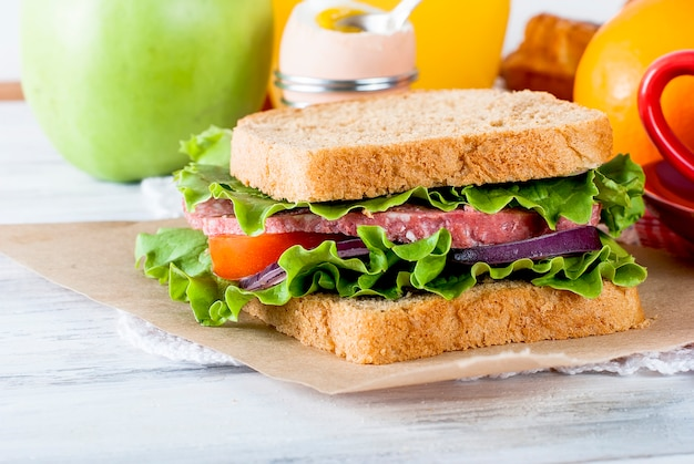 Sandwich with bacon and vegetables on white background Premium Photo