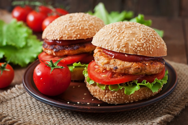 Sandwich with chicken burger, tomatoes and lettuce Free Photo
